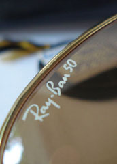 photo of NOS Ray-Ban 50th anniversary sunglasses 62mm. logo view sm