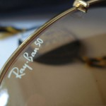 photo of NOS Ray-Ban 50th anniversary sunglasses 62mm. logo view